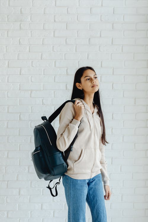 Medium Shot Of A Lady Carrying Her Backpack