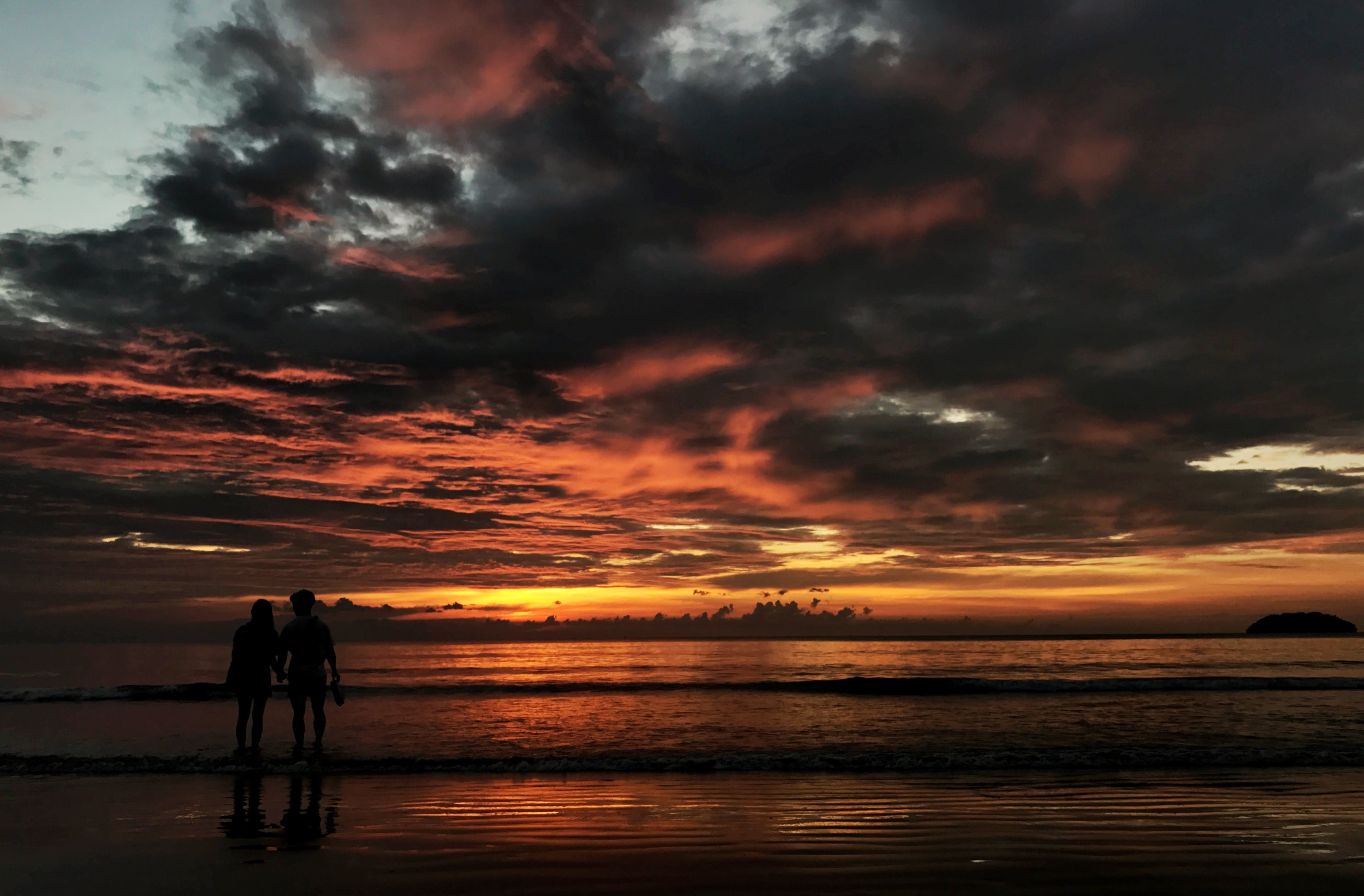 Two Person Standing on Beach Silhouette Photo
