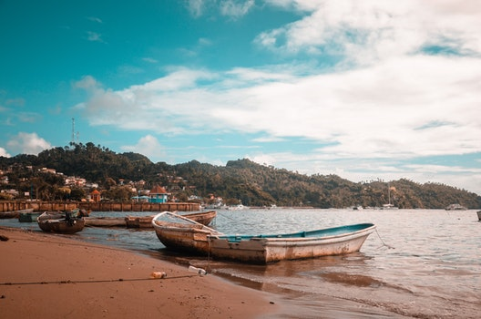 Boats On Seashore During Daytime