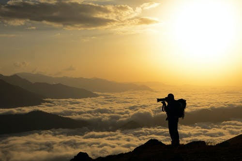 Kostnadsfri bild av bakgrundsbelyst, gryning, hav av moln