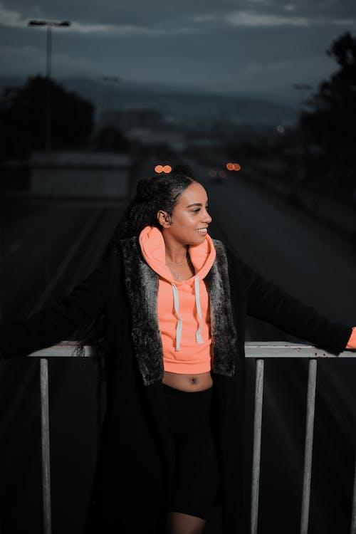 Woman in Black Jacket Standing