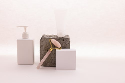 Pink Facial Roller and White Dispenser Pump