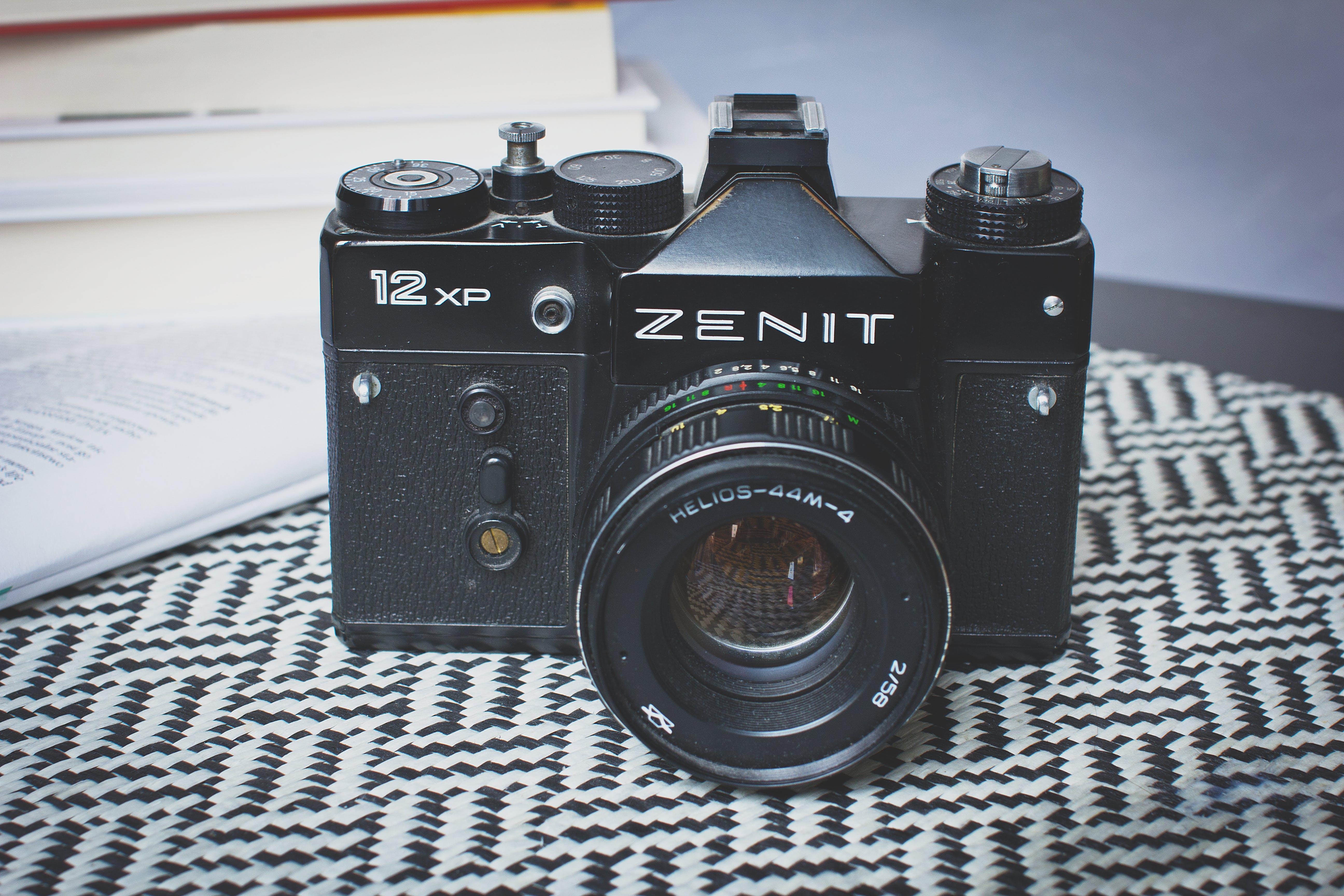 Black Zenit Dslr Camera on Top of Table