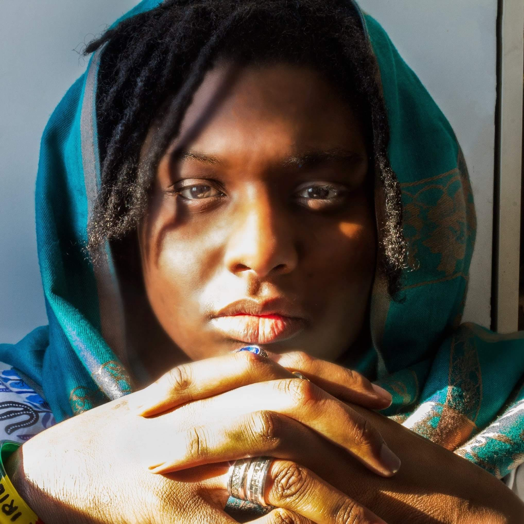 Woman With Dreaded Hair Wearing Green Hijab
