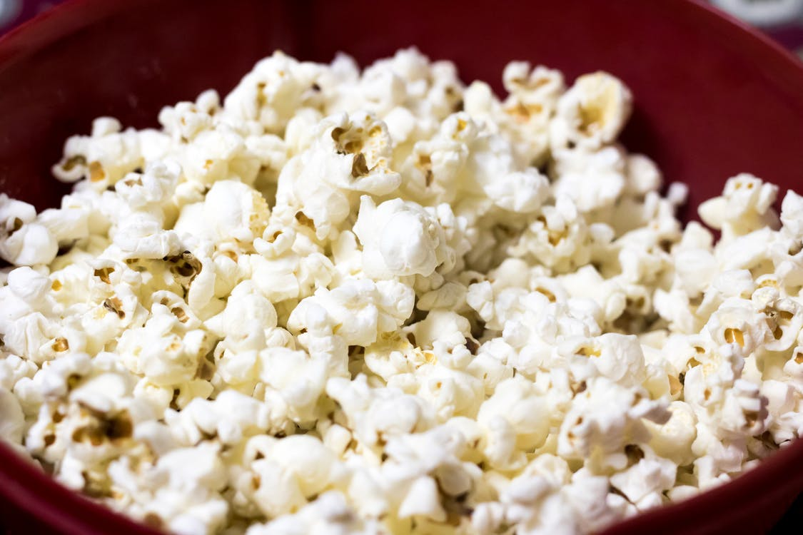 Selective Focus Photography of Popcorns on Bowl