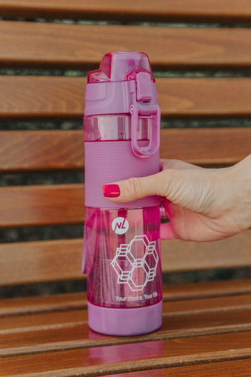 Pink and White Plastic Bottle