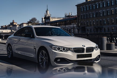 White Luxurious BMW Car Parked On The Street