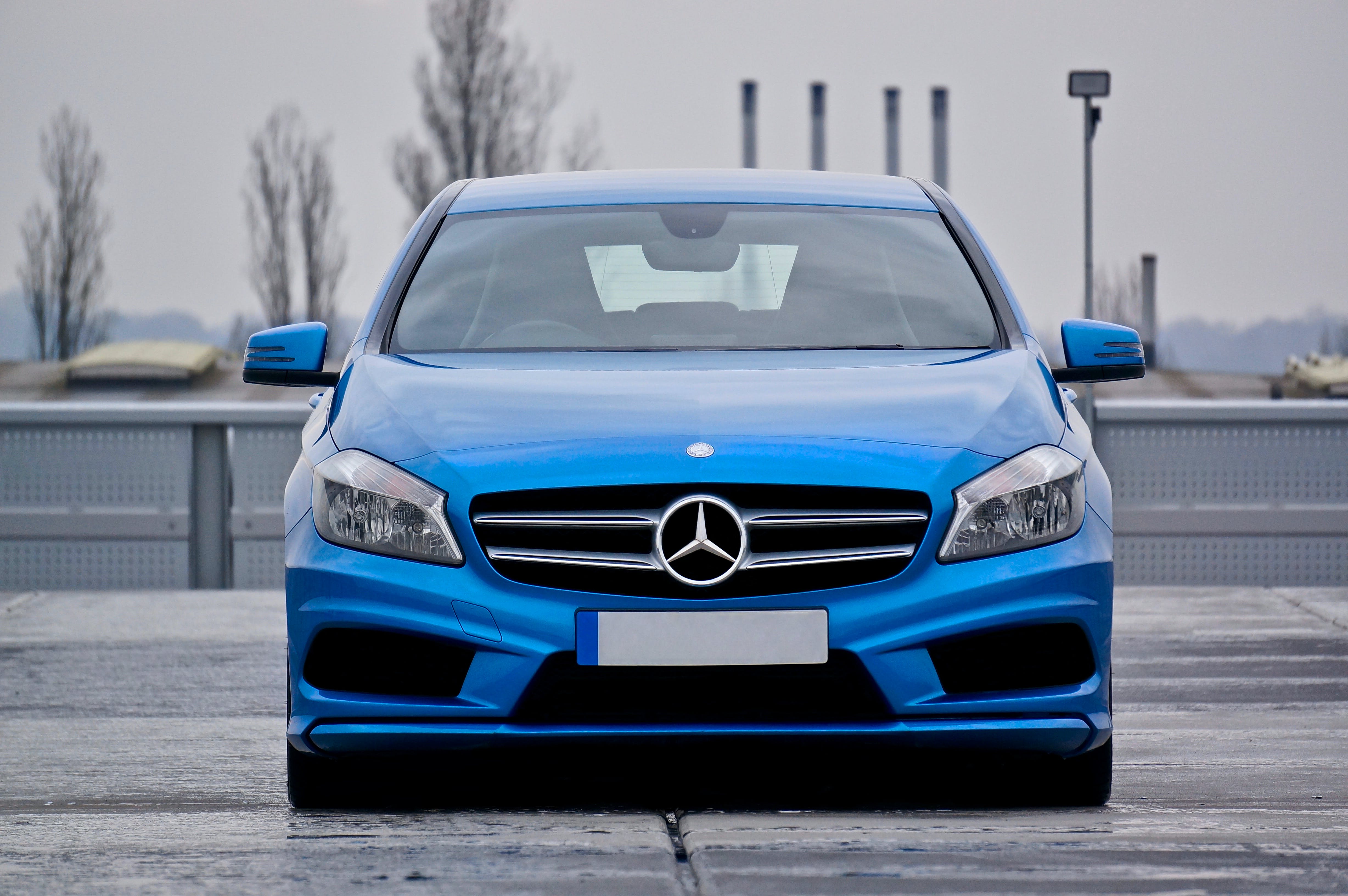 Blue Mercedes Benz Car Parked