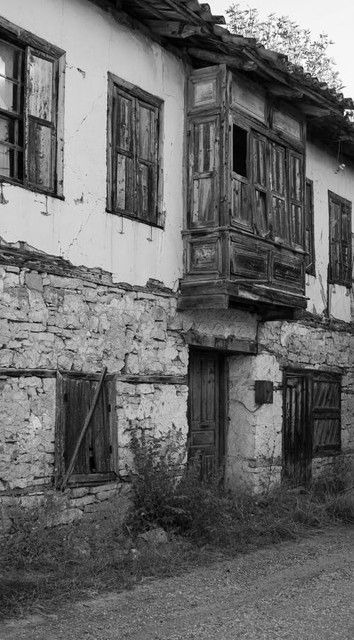A Dilapidated Building with Covered Windows