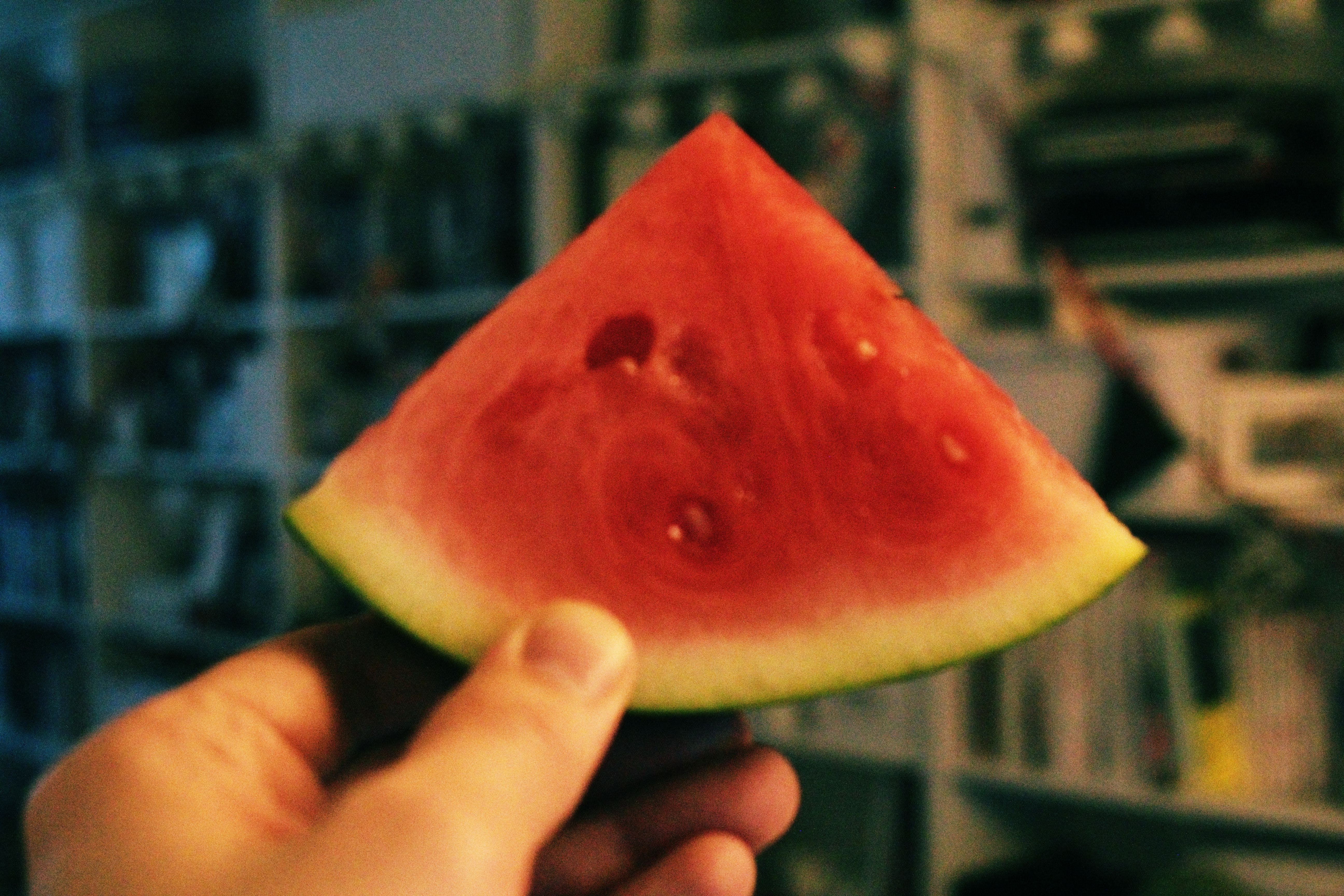 Person Holding Sliced Watermelon