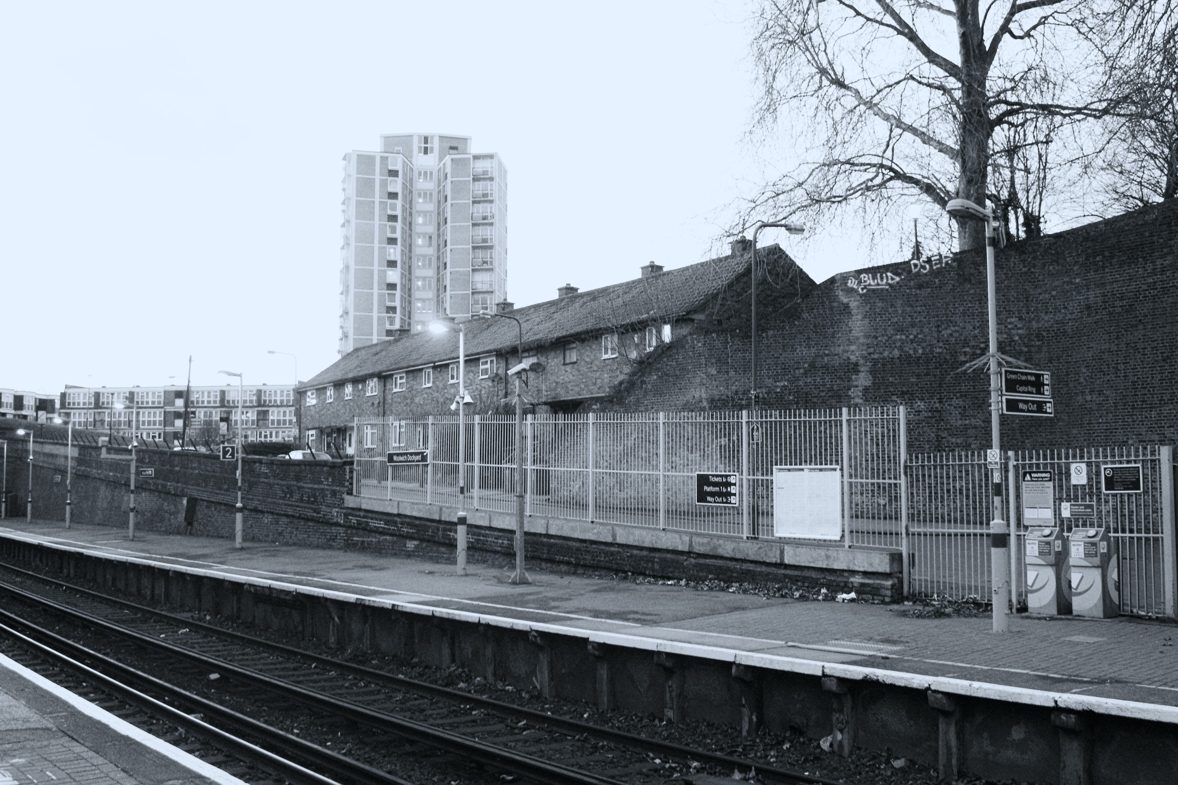 Free stock photo of black and white, council house, train station, train tracks