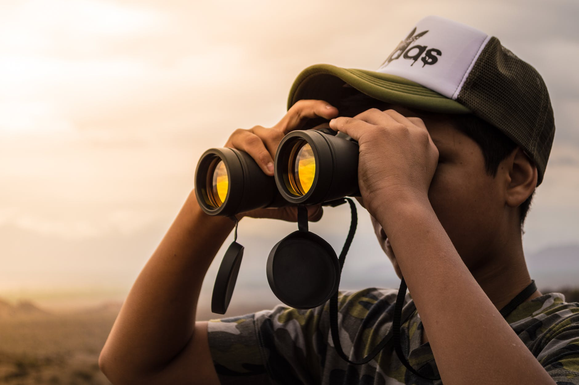 man looking in a binocular