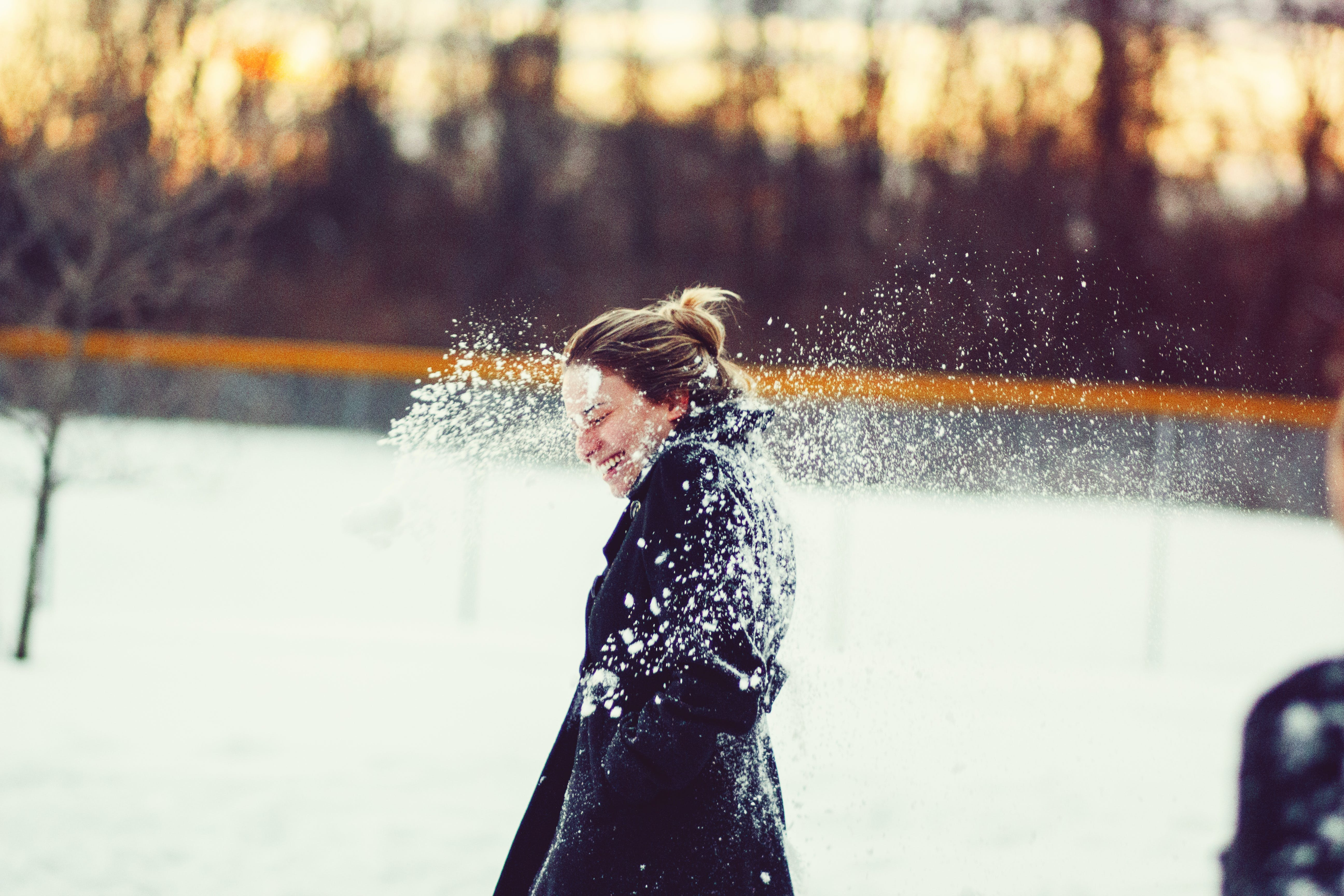 Woman In Black Coat Hit With Snowball On The Head