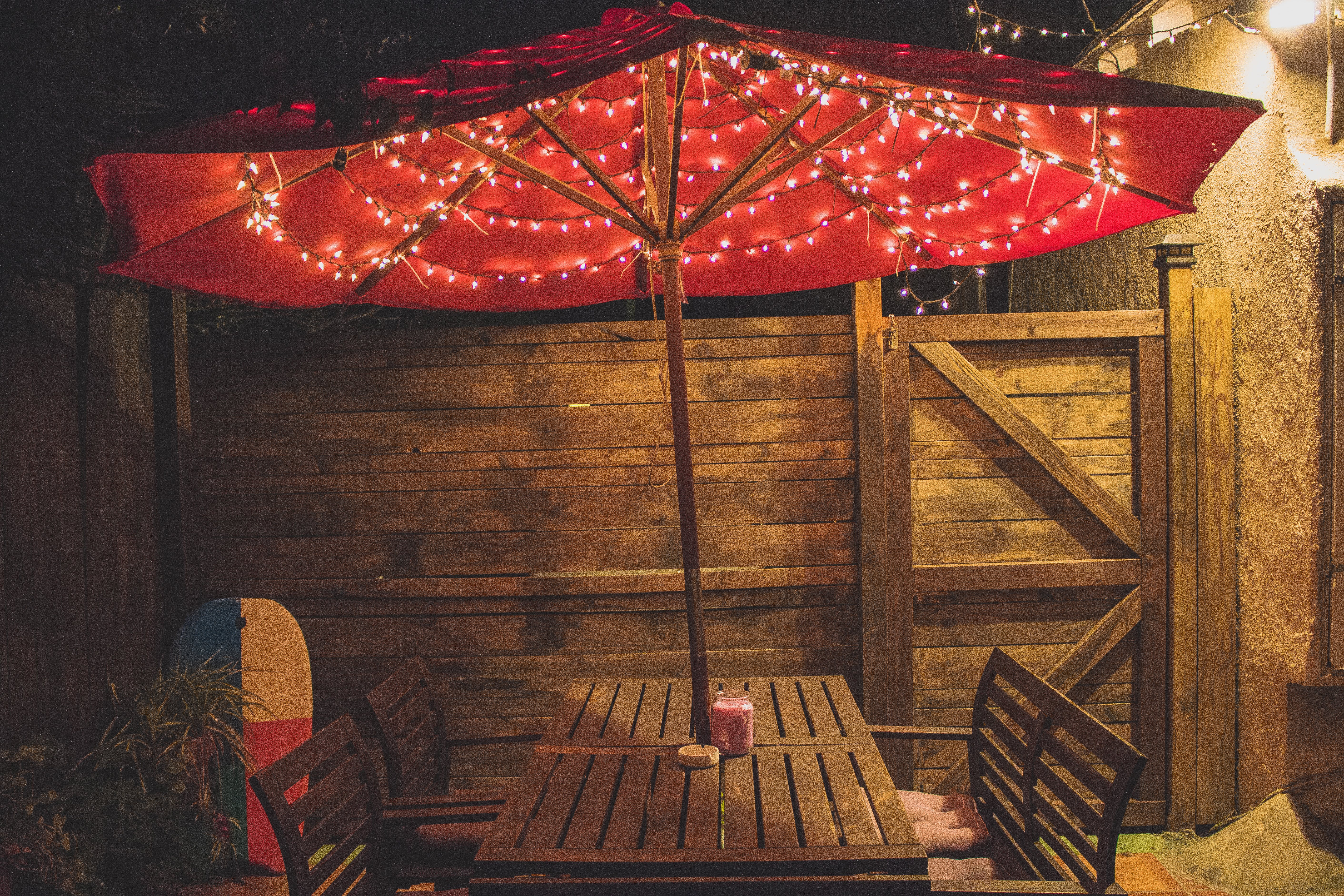 Photography of Red Patio Table With String Lights