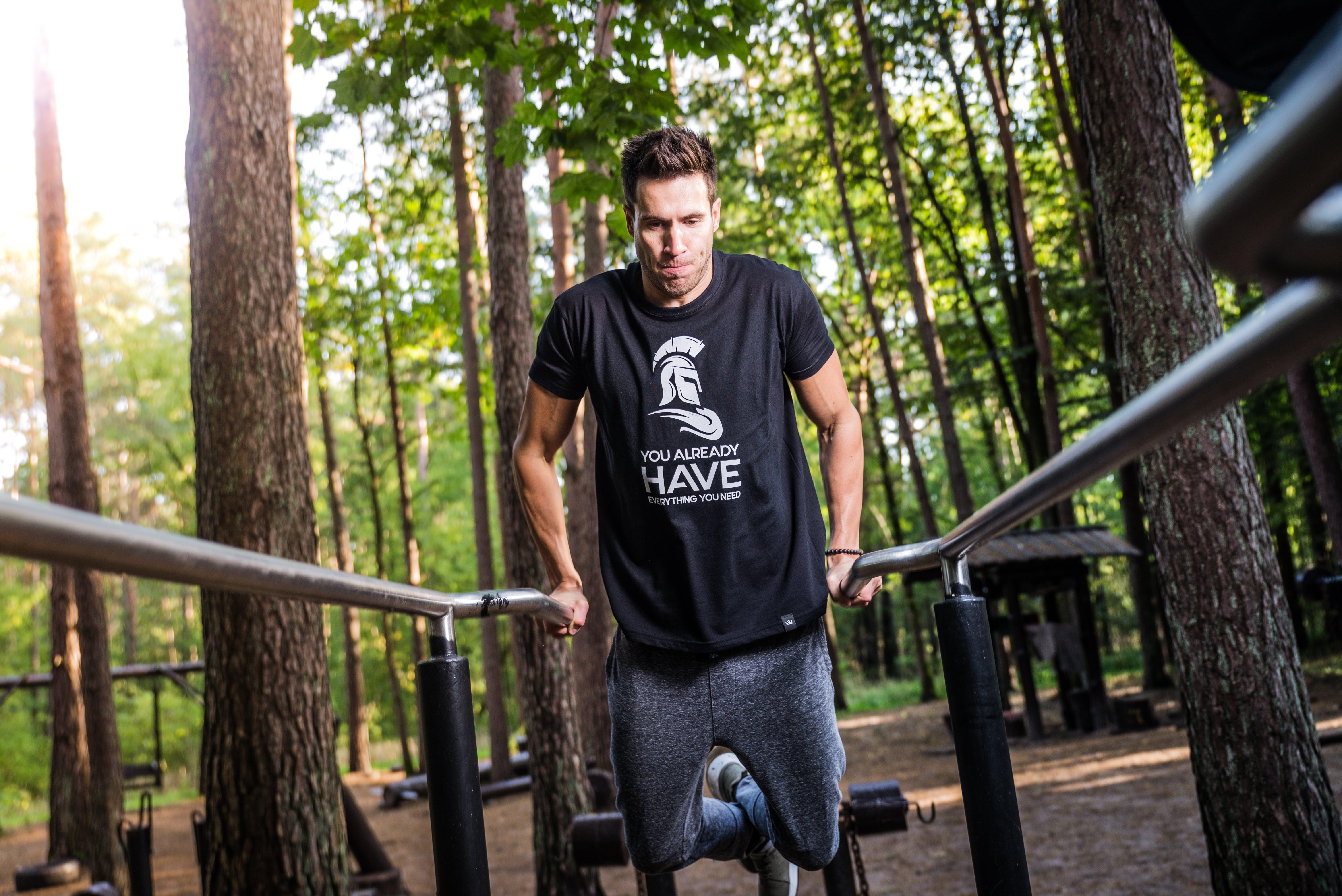 Man In Black T-shirt Doing Exercise