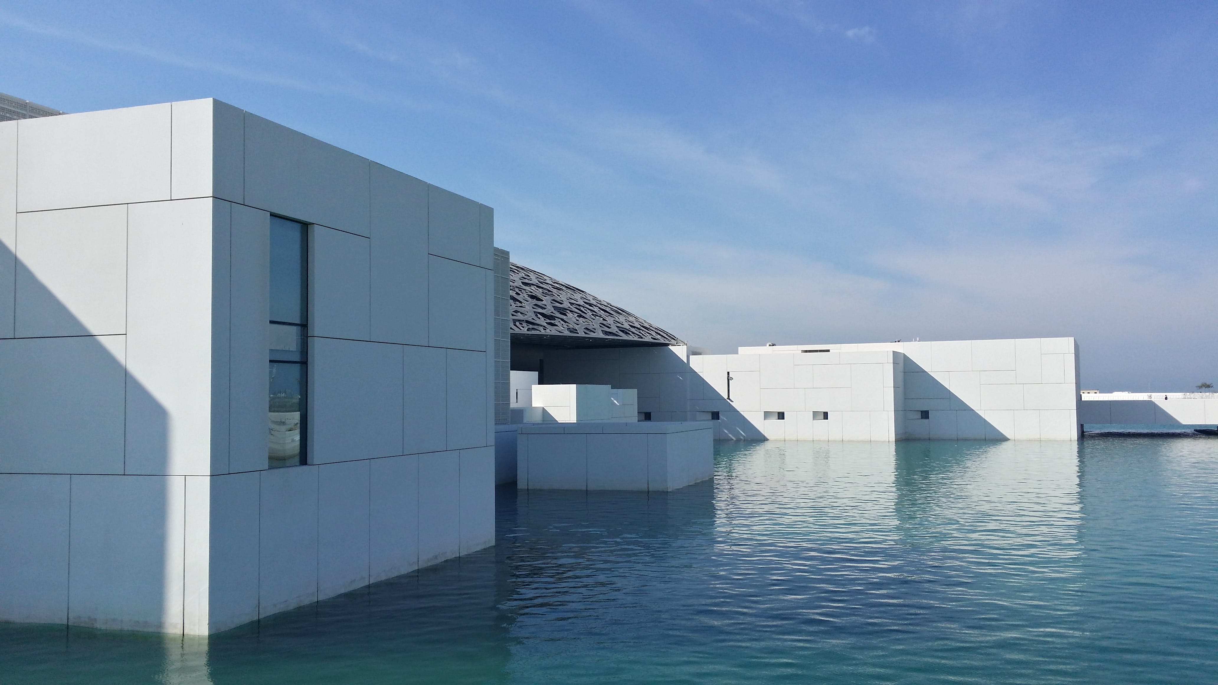 White Building Surrounded With Water