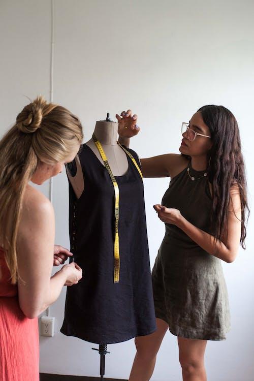 Fashion Designers Making a Dress