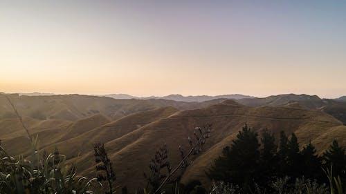 Gratis arkivbilde med fjell, panoramautsikt, solnedgang, syn
