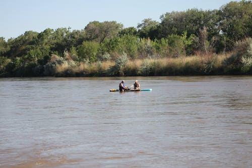 Men Riding Kayak on Lake