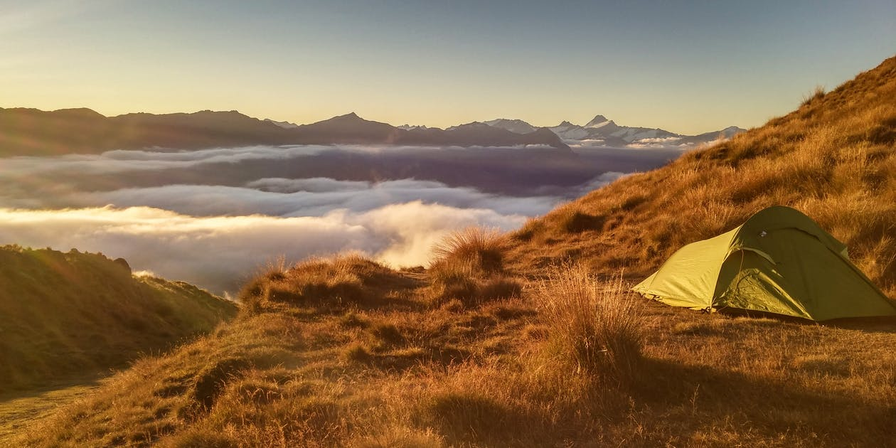 Green Tent On Top Of Mountain