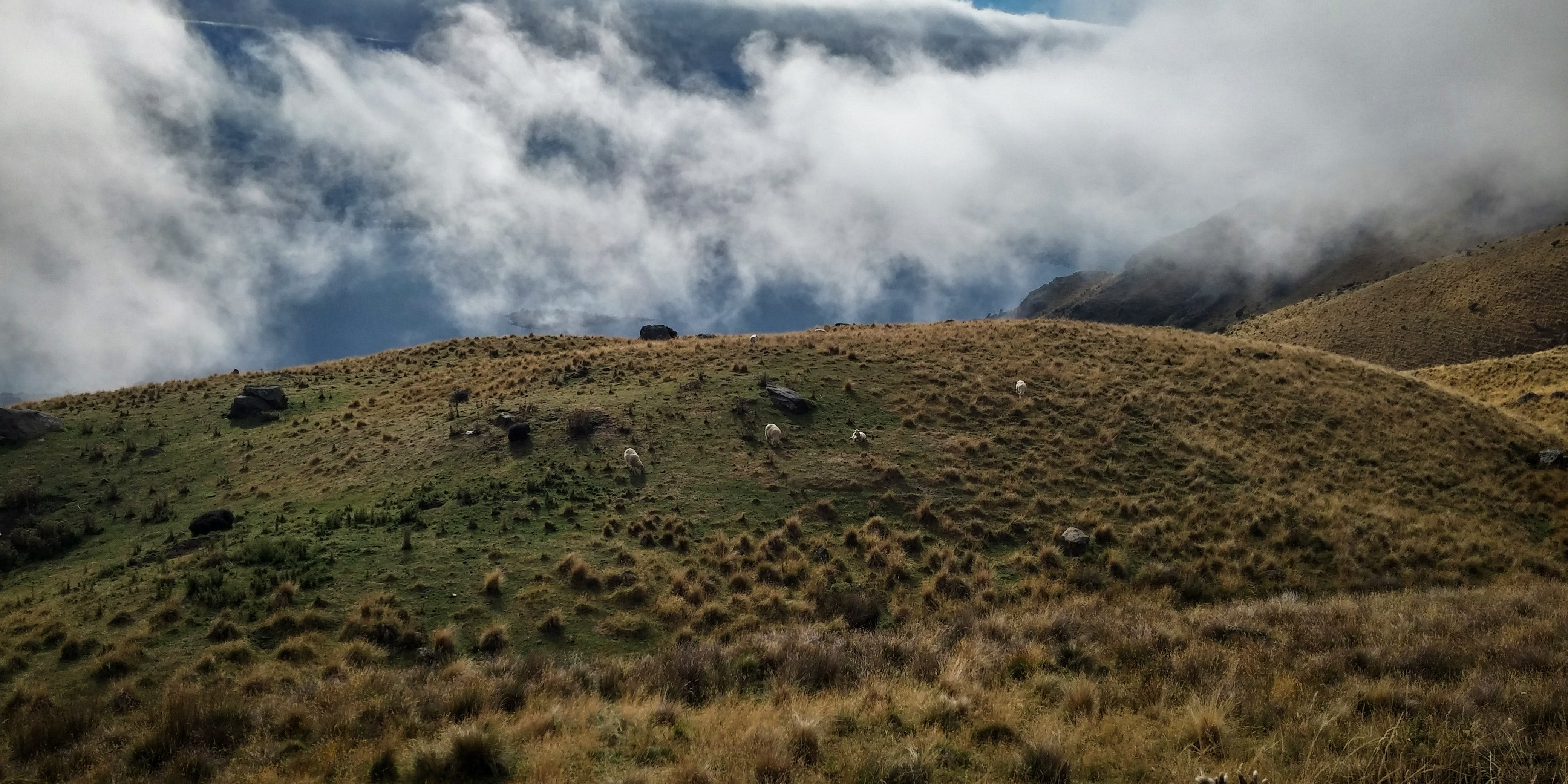 Green Hill Covered by Clouds
