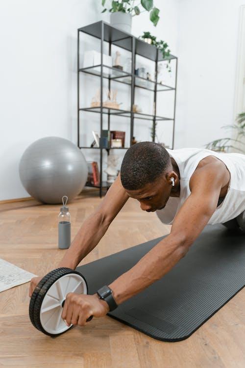 Man Doing an Ab Wheel Exercise