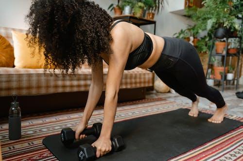 Woman in Black Activewear Exercising Indoors