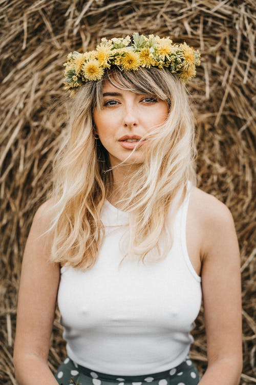Young woman with flower wreath on head