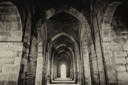 Grayscale Photo of a Hallway
