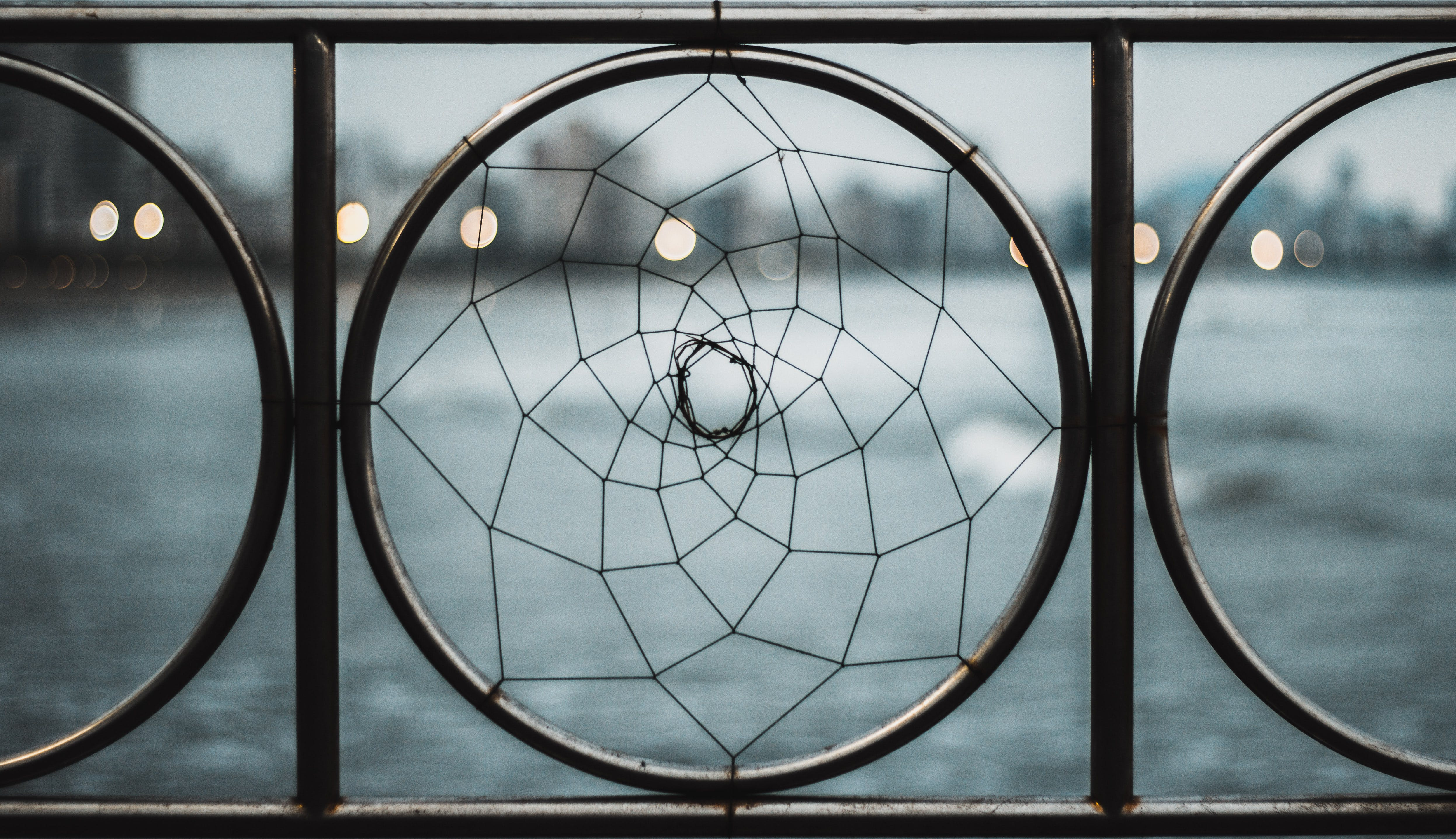 Closeup Photo of Black Wrought Iron Frame Near Body of Water