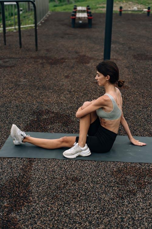 Woman on a Yoga Mat Doing a Yoga Pose