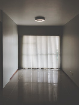 Empty Room With Closed Window Curtains