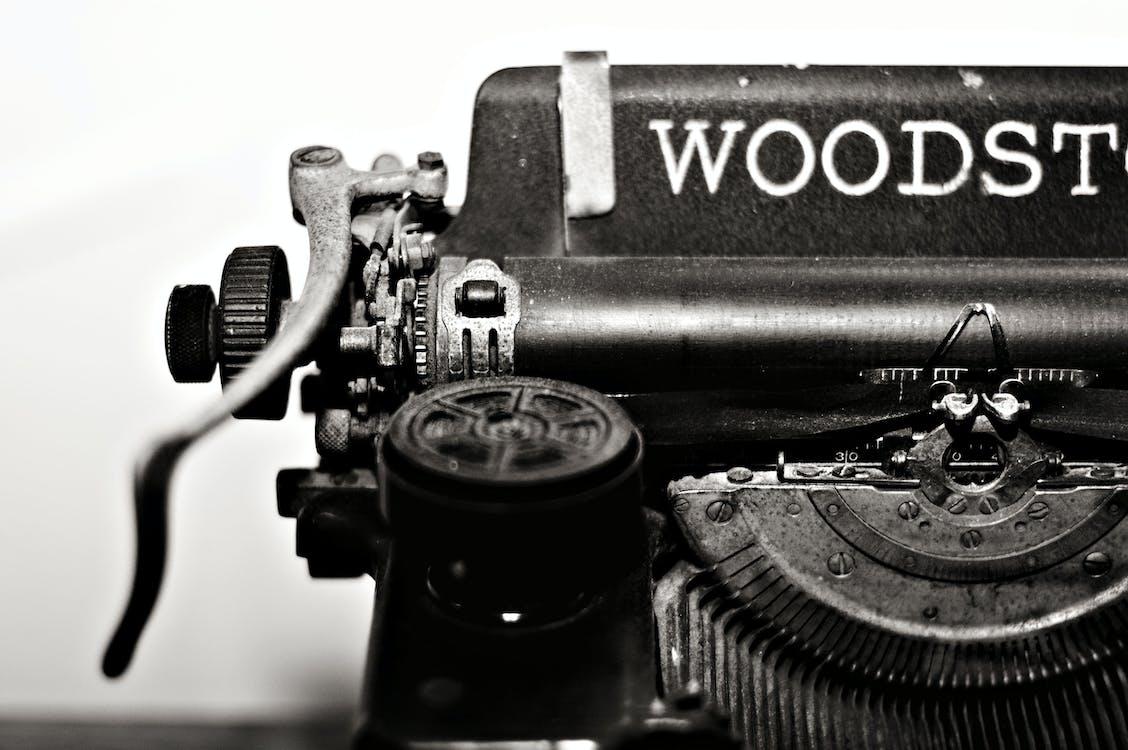 Grayscale Photo of Typewriter