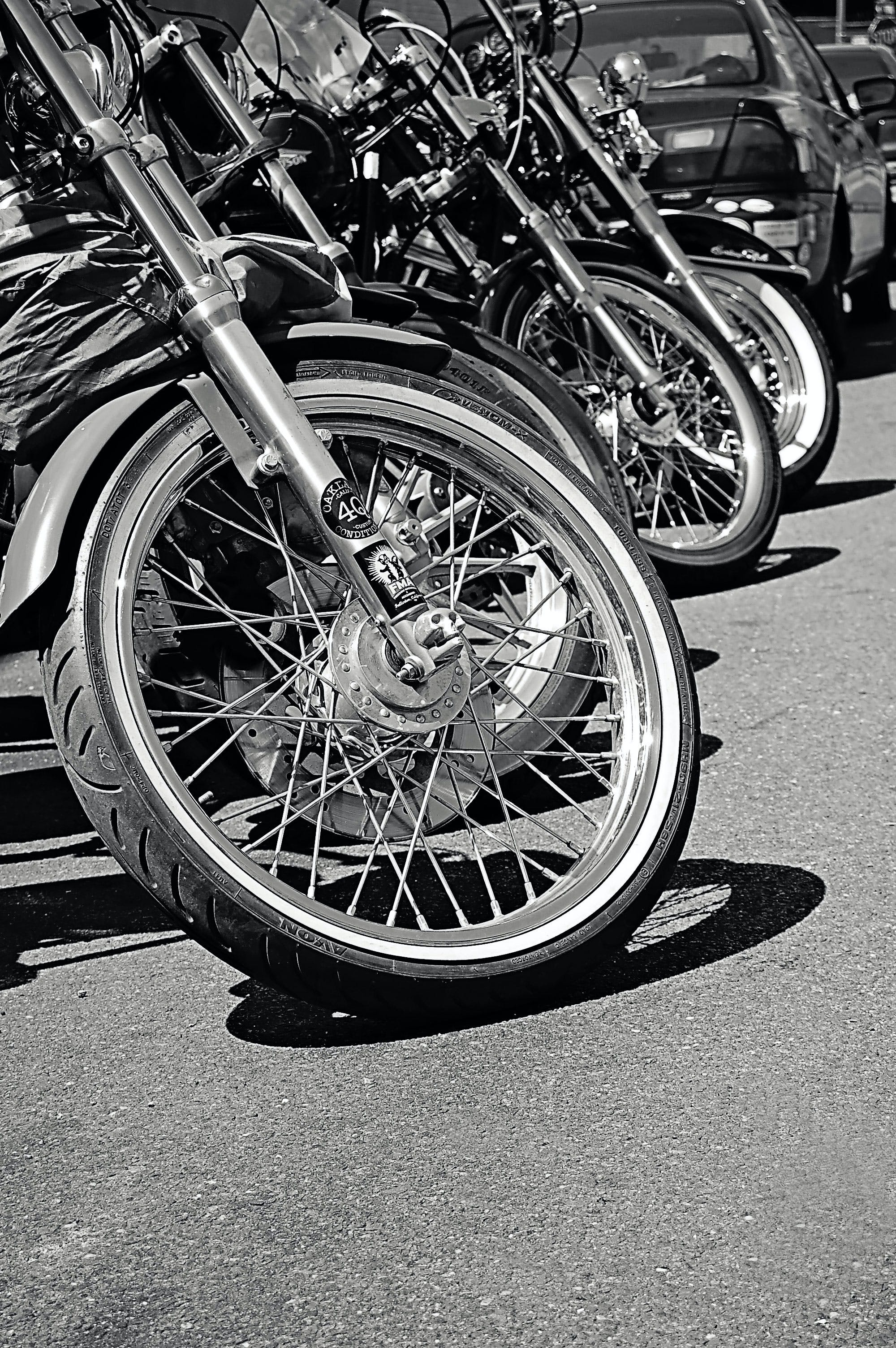 Grayscale Photo of Parked Motorcycle