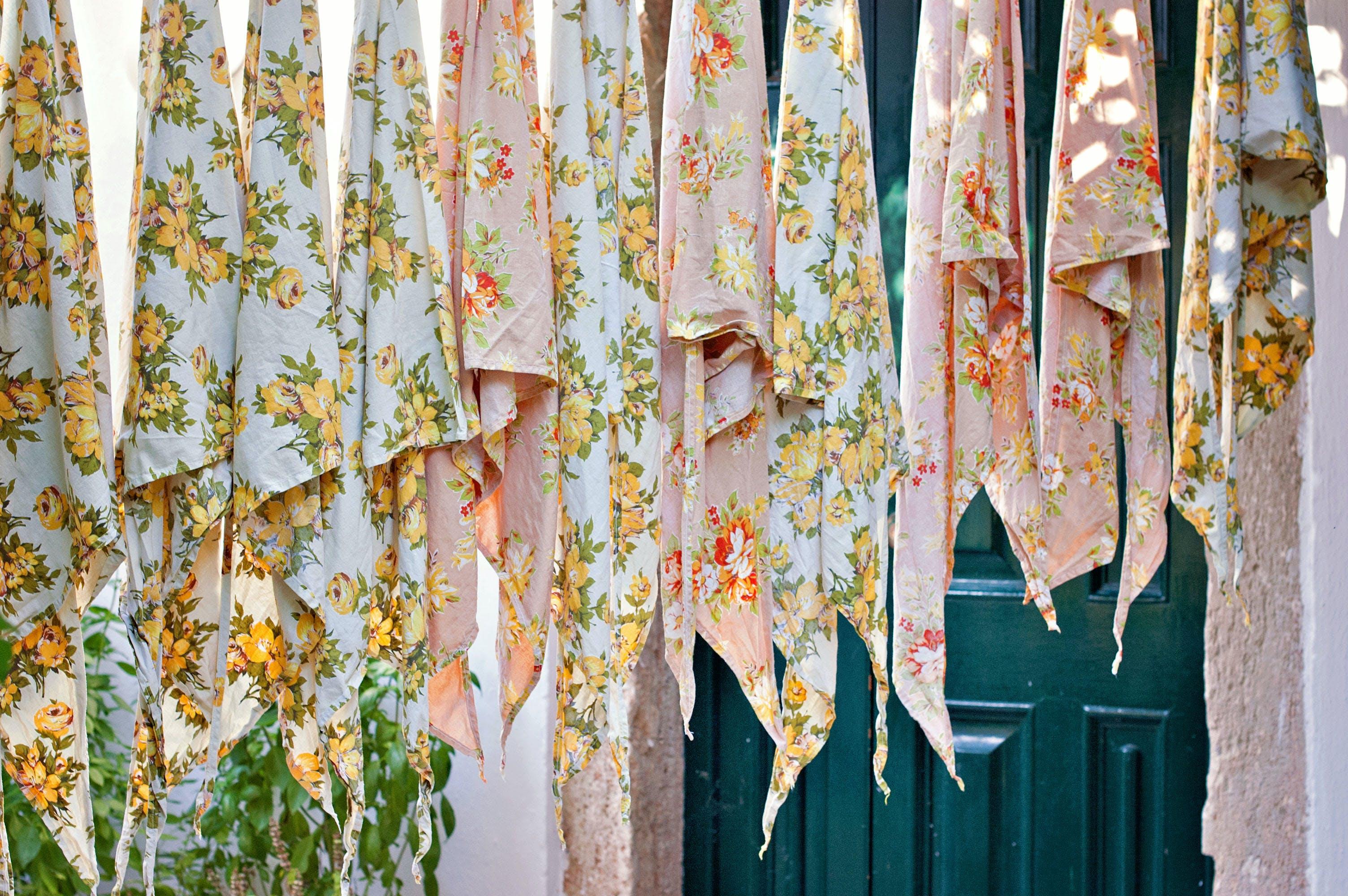 Assorted Textile Lot Hanging Beside Blue Wooden Door