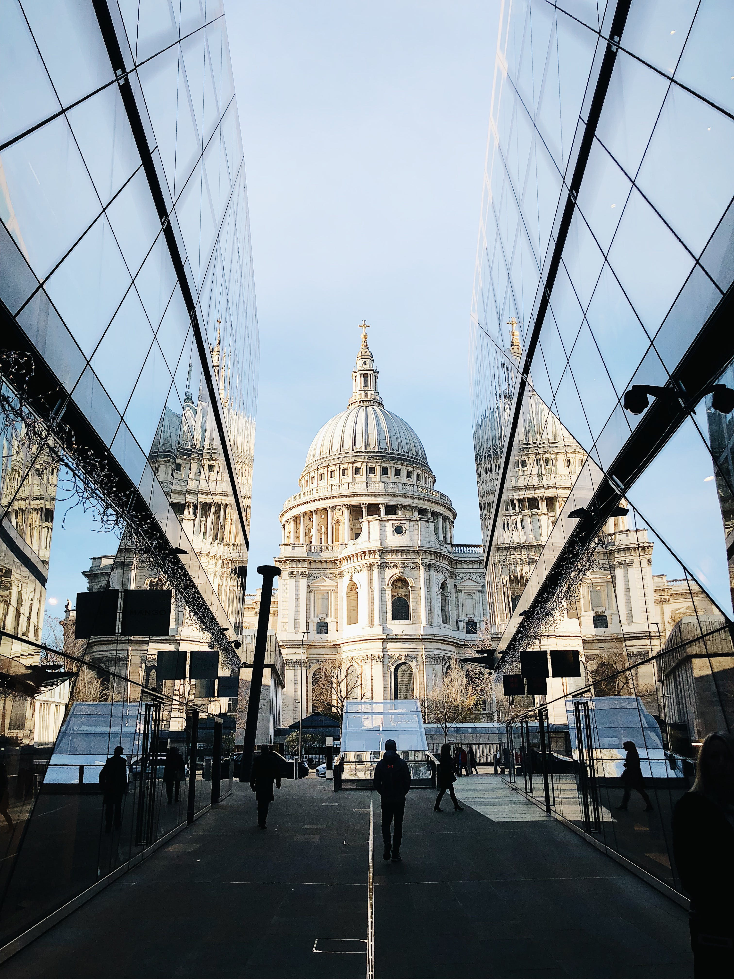 White Dome Cathedral in Between Curtain Wall Building at Daytime