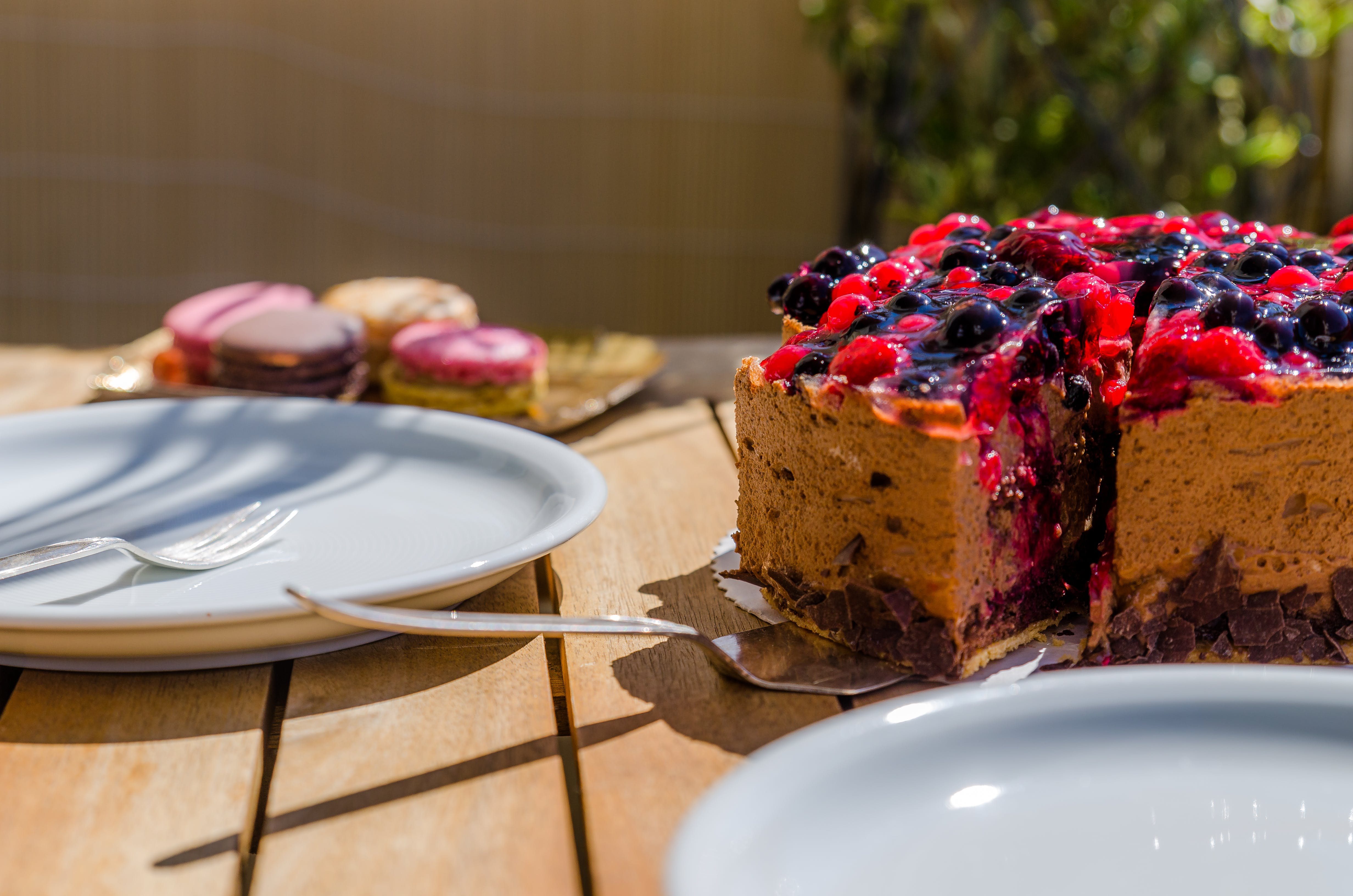 Cake Near White Ceramic Plate on Brown Wooden Table