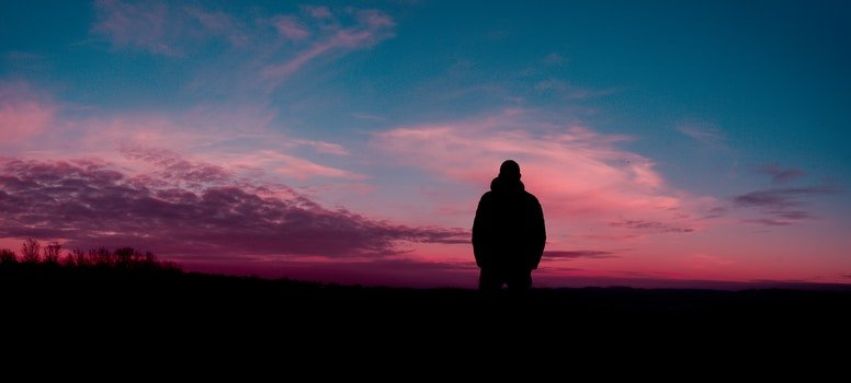 Silhouette of Human With Sunset Background
