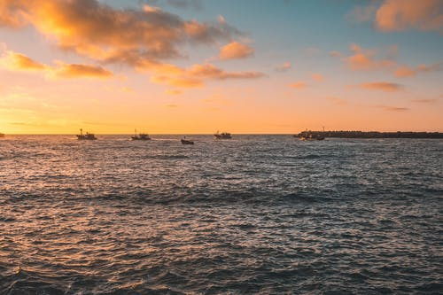 Boats Sailing on the Sea during Golden Hour