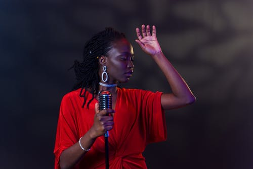 A Female Singer in Red Dress