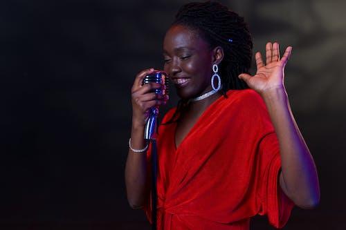 A Woman Singing Emotionally