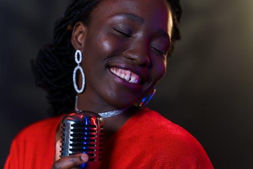 Close-Up Photo of Woman Singing Emotionally