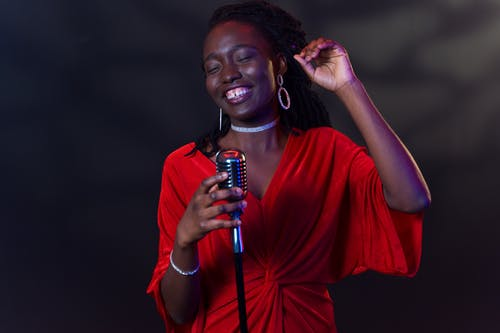 A Woman Singing Cheerfully