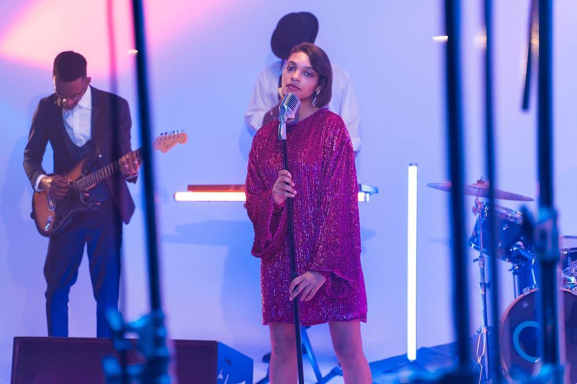 A Female Vocalist in Glittery Dress