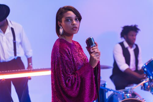 A Female Vocalist in Glittery Dress Singing