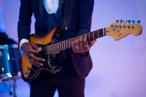 Person Playing an Electric Guitar