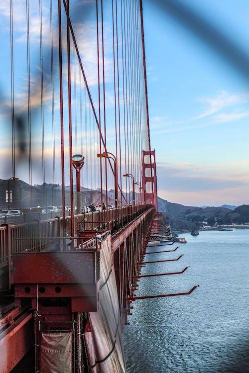 Red Metal Bridge over Body of Water