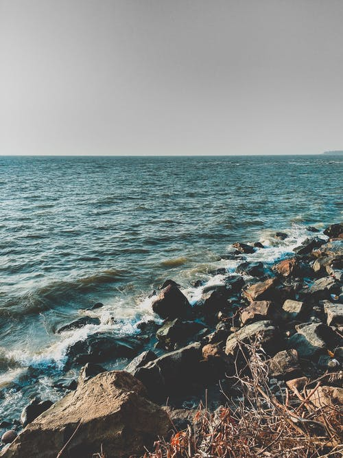 Photos gratuites de bord de mer, caillou, cailloux, ciel
