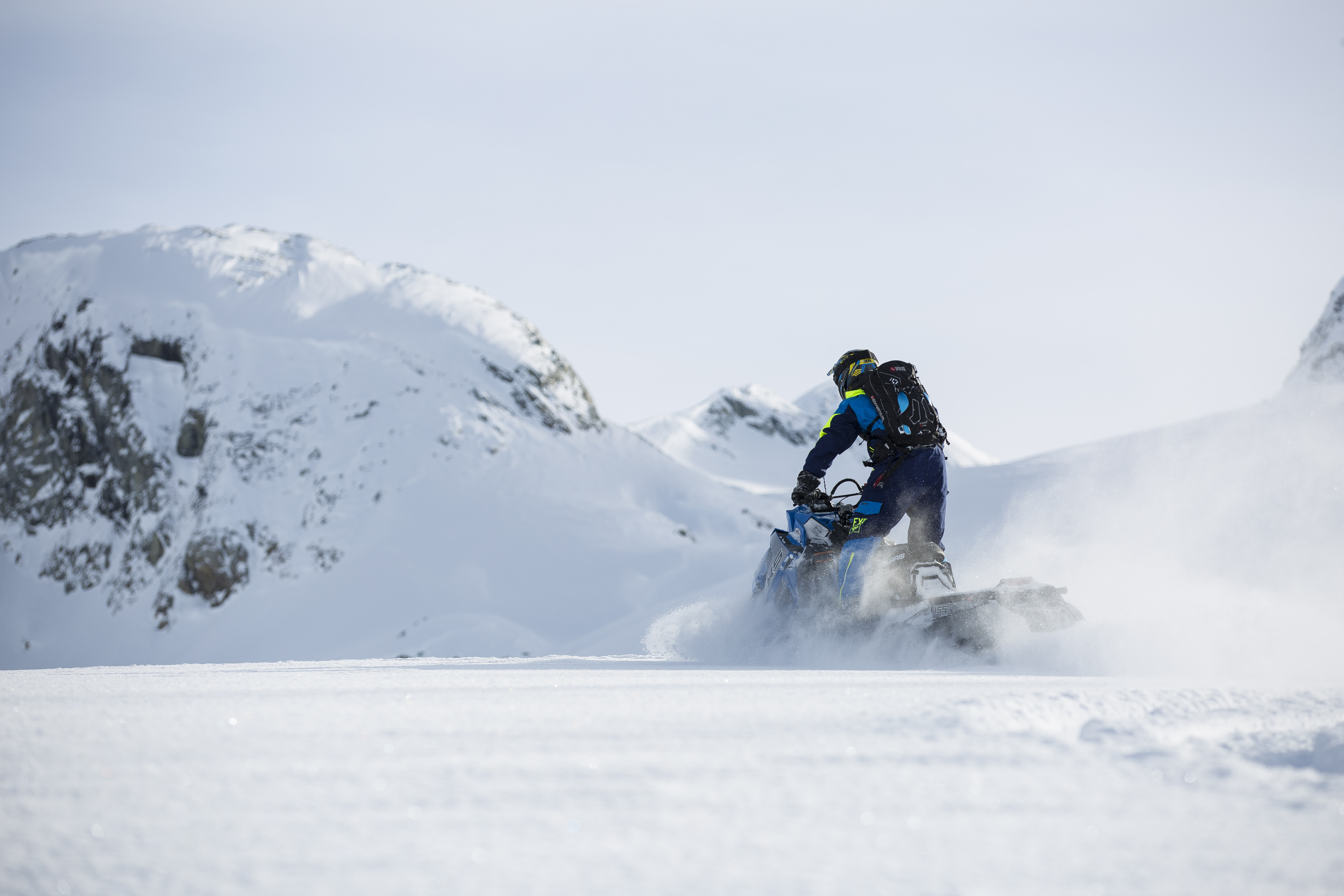 Person Riding on Snowmobile during Winter