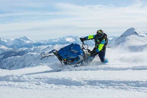 Man Riding Blue Snow Ski Scooter